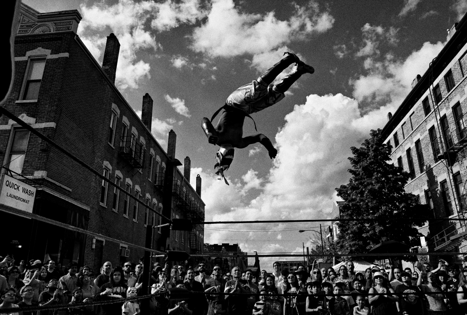 During the Mole de Mayo, a yearly mole sauce competition in the Pilsen neighborhood in Chicago, a luchador demonstrates his high flying aerial jump during a Lucha Libre show.