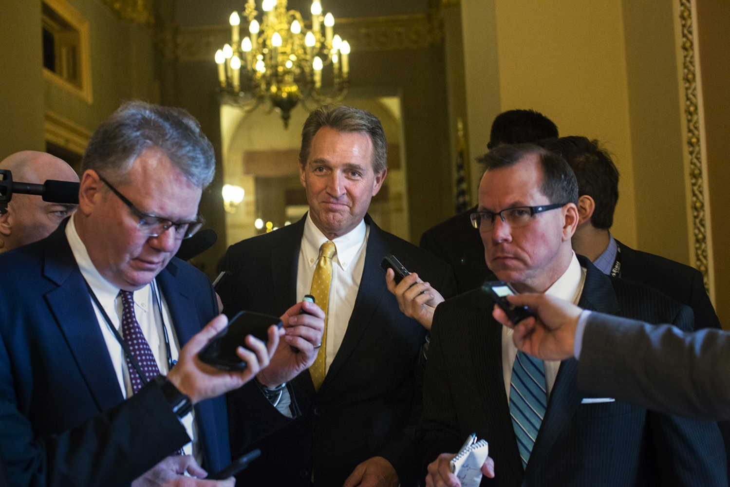 Sen. Jeff Flake answers questions from reporters in the U.S. Capitol Building.