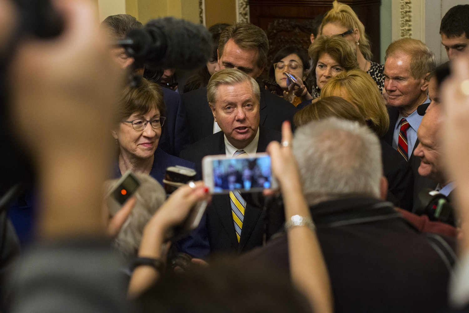 Senators Lindsey Graham and Susan Collins talk with reporters about the deal made to reopen the government.