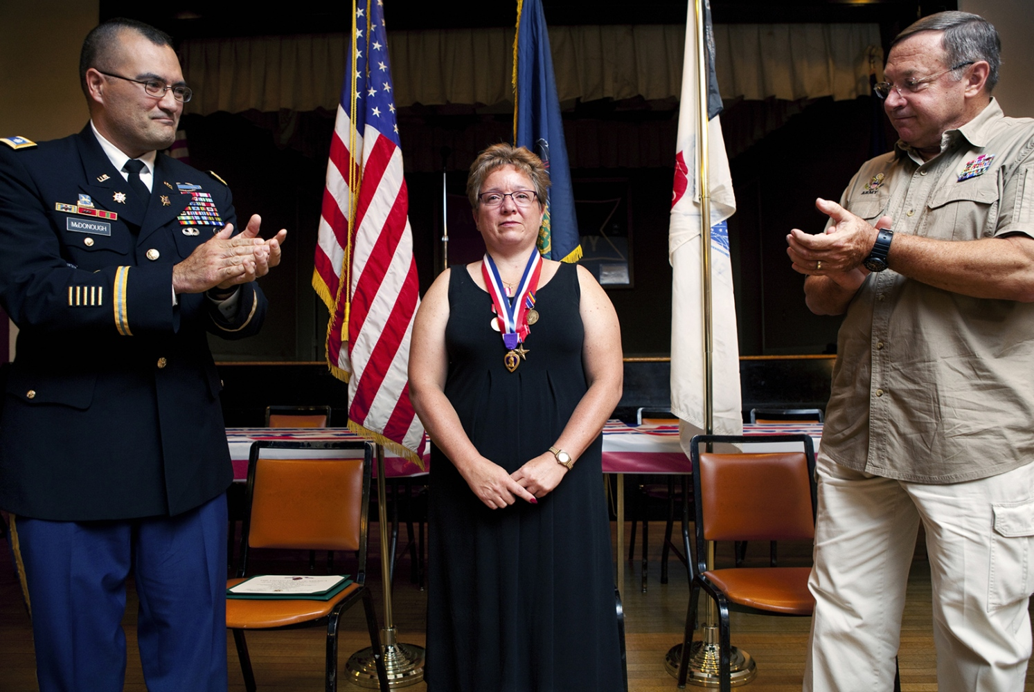 Retired Army Maj. Michelle Dyarman finally recieves a Purple Heart medal for the head trauma injuries she sustained while deployed in Iraq. For years, the Army denied Purple Hearts to soldiers who suffered severe comcussions.