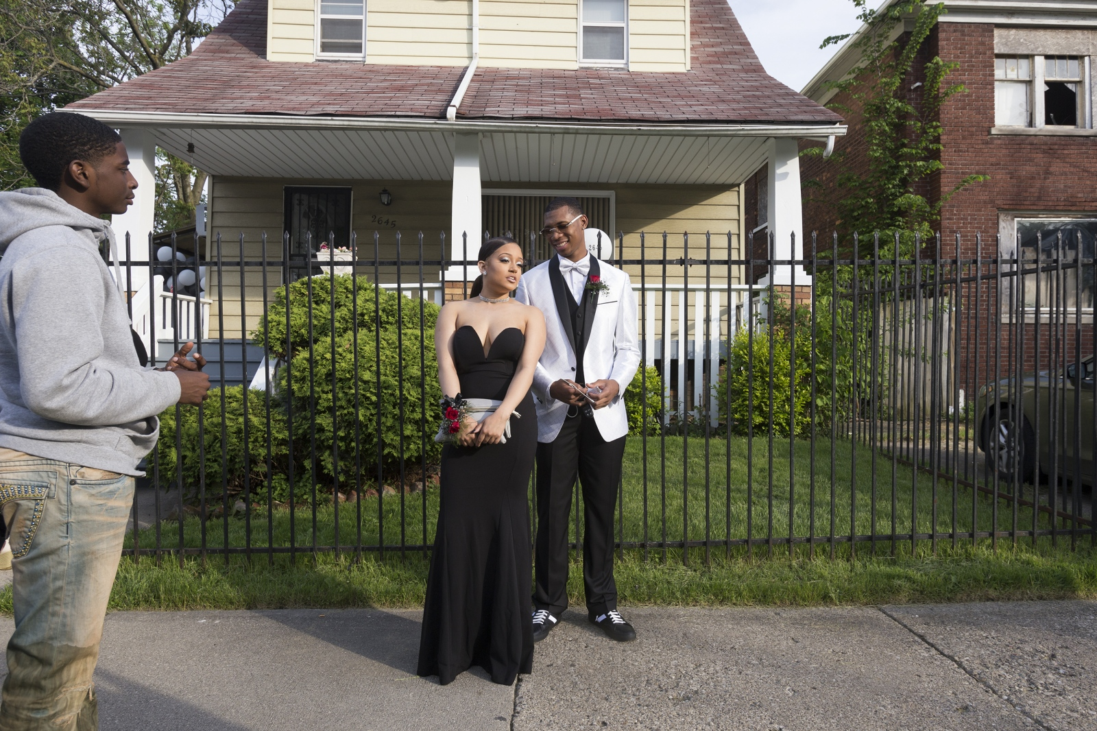 Destiney Drake, 18, left, stands next to her prom date Michael Green, 18, outside Green's house before prom. Green was shot when he was 12 years old while playing basketball on the same street he lives on today. Green graduates this Spring and will go on to play basketball for Miles College in Alabama.