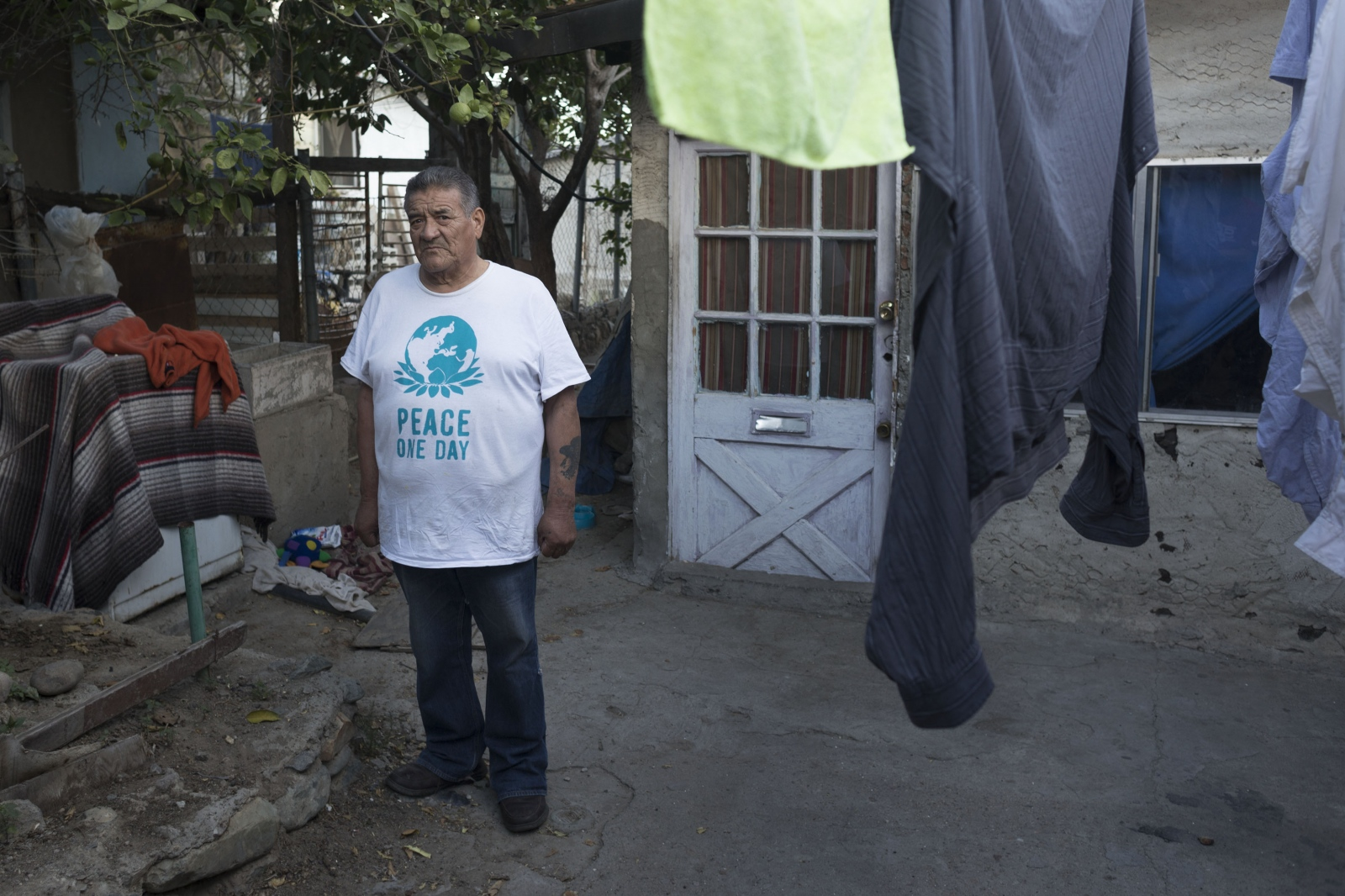 Deported Army veteran Andres De Leon, 71, poses for a portrait outside his dilapidated home in Tijuana. De Leon found Hector Barajas and the Deported Veterans Support House from reading a newspaper article.