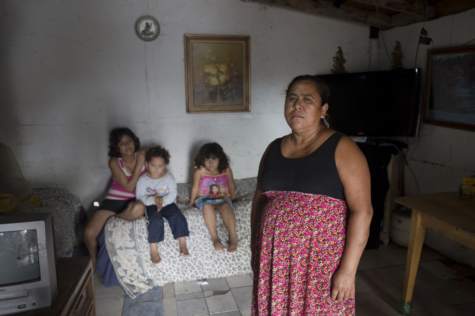 Leticia Abad stands with some of her children and grandchildren inside their small home in Rosarito, Mexico. Her partner, Augustin, is a deported veteran and is currently in rehab for alcoholism. He was recently diagnosed with cirrhosis of the liver and is petitioning for a humanitarian parole visa to allow him back into the U.S. for a liver transplant.