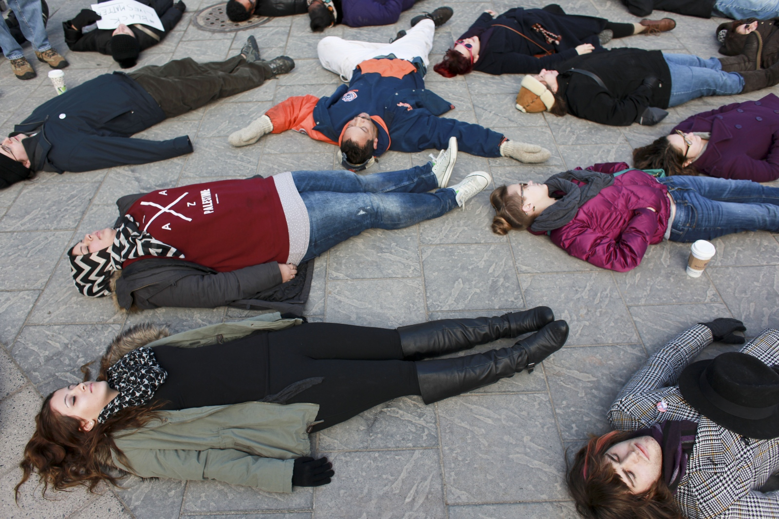 Protestors stage a 'die-in' on Thursday afternoon at Campus Martius Park in downtown Detroit in a rally over the non-indictment of Eric Garner, a black New York man who died during a police arrest.c
