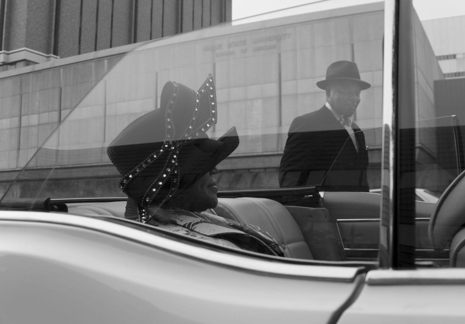 Ebenezer AME First Lady Carol Ann Pettigrew Thomas, left waits for her husband, Pastor Mikarl Thomas Sr. to join her in the car for the Motorcade, which recreates the congress' move from Midtown to its present home at 5151 W. Chicago in Detroit.