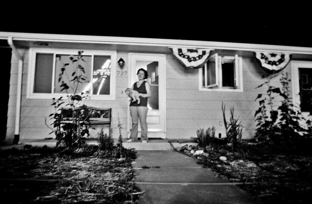 New to the United States and motherhood, Marie, a painter and school teacher from Eastern Europe drinks the wonderful spectacle of lights from her porch-front view of a small Colorado town fair.