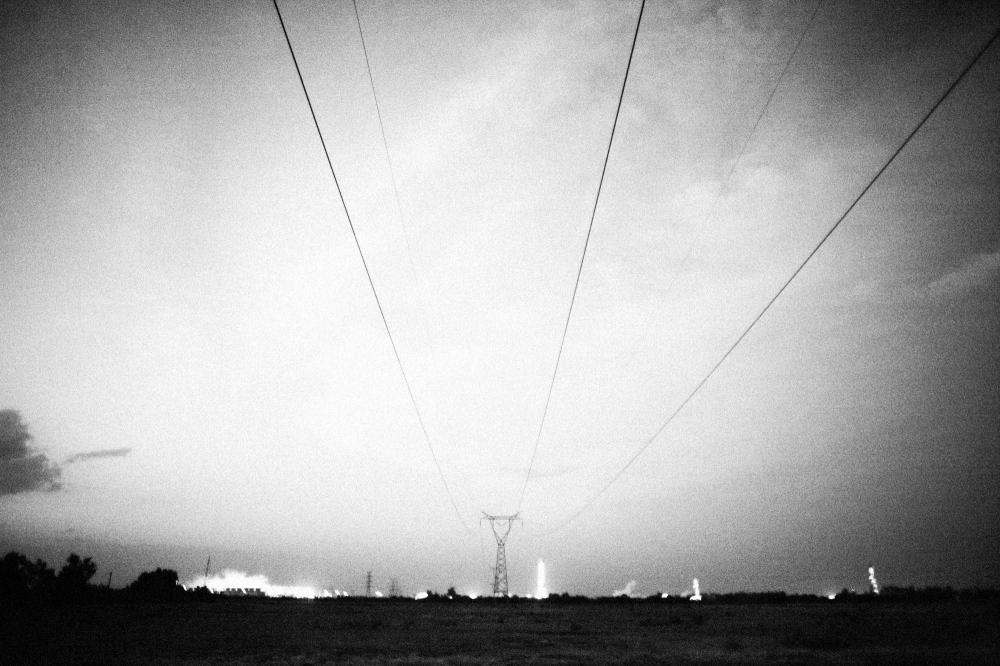 Power lines stretch from the Serra Prieto geothermal powerplant in Sonora Mexico. The United States purchases a large amount of power from the plant, which doesn't have to abide by the strict environmental standards imposed in the USA. Because of the lax Mexican regulation, the plant can provide power cheaply to its US consumers.