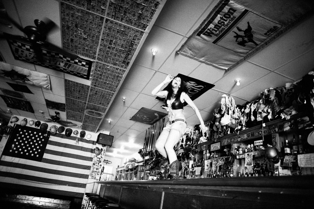 "Jasmin, a bartender at the Hogs and Heifers bar in downtown Las Vegas dances on the bar to try and drum up mid-day business. The movie ""Coyote Ugly,"" with its dancing girl bartender stars was inspired by the Hogs and Heifers bar."