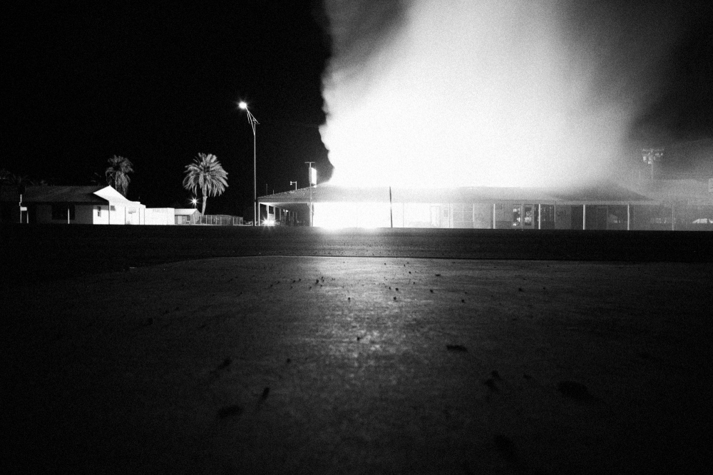 A fire destroys a business in the Salton Sea area of the Imperial Valley in California. The business was one of the last businesses standing in the mostly deserted area that was once a thriving tourist destination, but deteriorated as the sea, which was created by the Colorado River, died from pollution and dried out from the effects of global warming.
