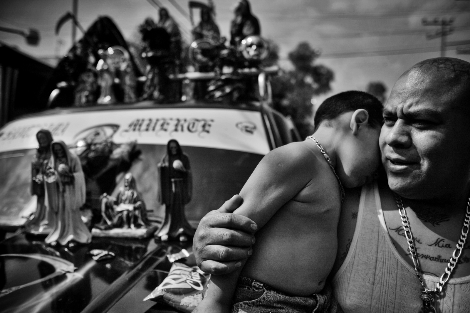"Ex-convict ""Gerardo"" holds his son on the streets of Tepito, the roughest neighborhood in Mexico City. Gerardo gave up his life of crime to raise his family and devoted his life to the worship of Santa Muerte, or Saint Death. Gang members on the streets of Tepito give him a big birth out of respect. Tepito is controlled by drug cartels, and access to the neighborhood is strictly guarded. Police are only allowed to patrol its streets 2 days a week."