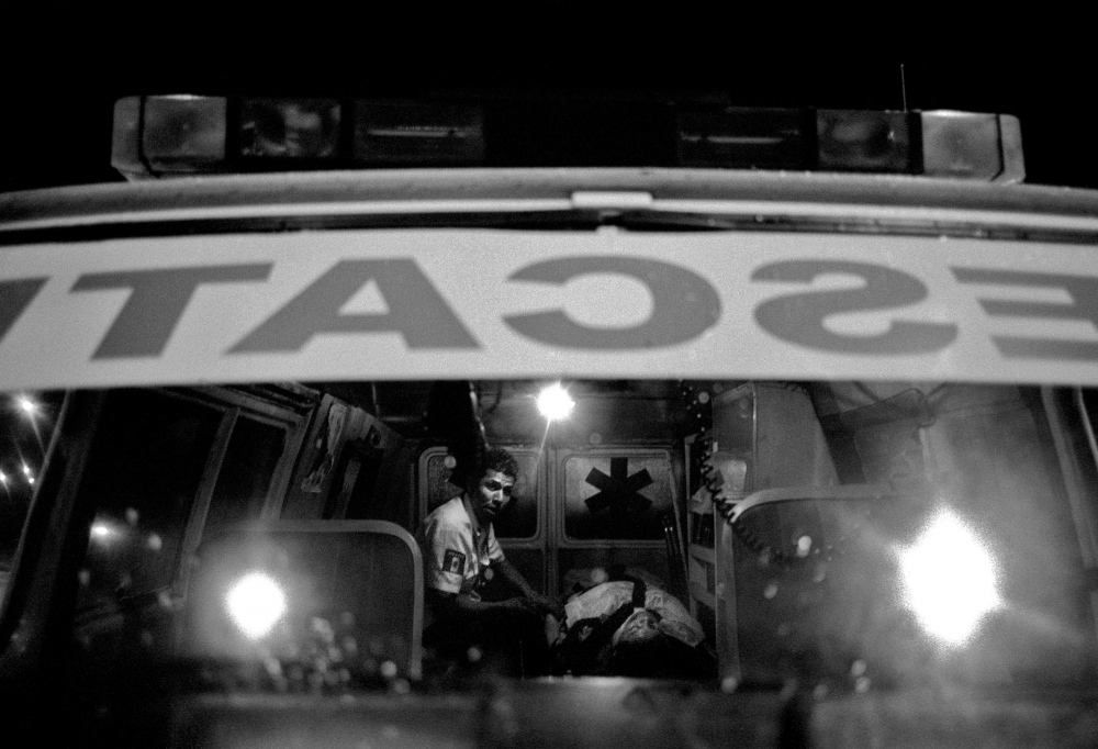 A medic does all he can to stabilize a trauma patient before transport to the hospital in Nezahualcoyotl, a notorious barrio on the outskirts of Mexico City which has become a front in the drug war.