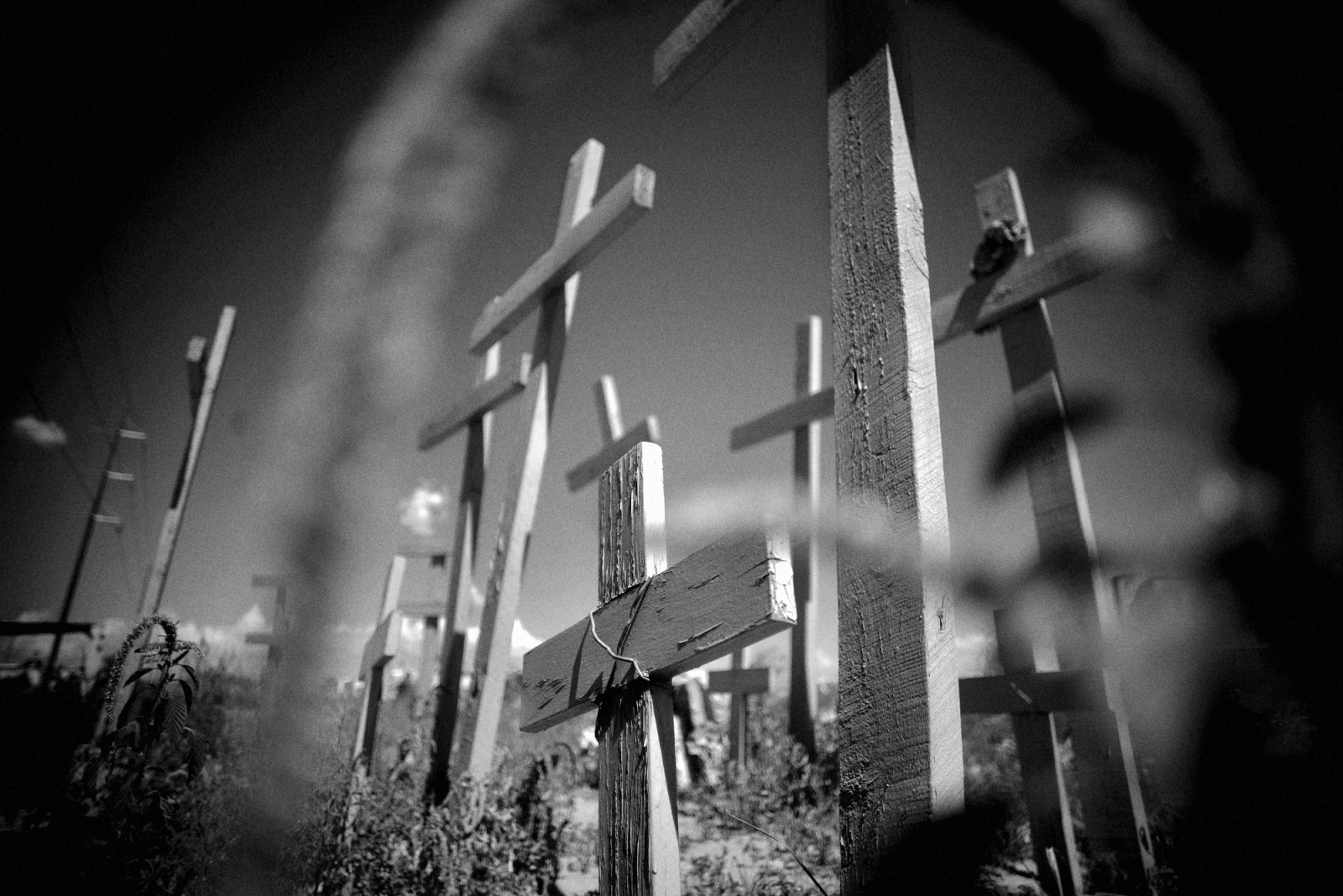 Clandestine graves are an all too common site in Juarez, Mexico. The city is gripped in a wave of violence as drug cartels battle each other and the federal authorities in the border town, which has lead to a more than ten-fold increase in homicides this year. Monuments such as this one can be found in well-known areas where bodies are regularly dumped. Eleven bodies were found piled one atop the other in this particular empty lot.