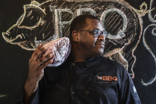 Maurice Bradford, owner of The BBQ for The City Paper.