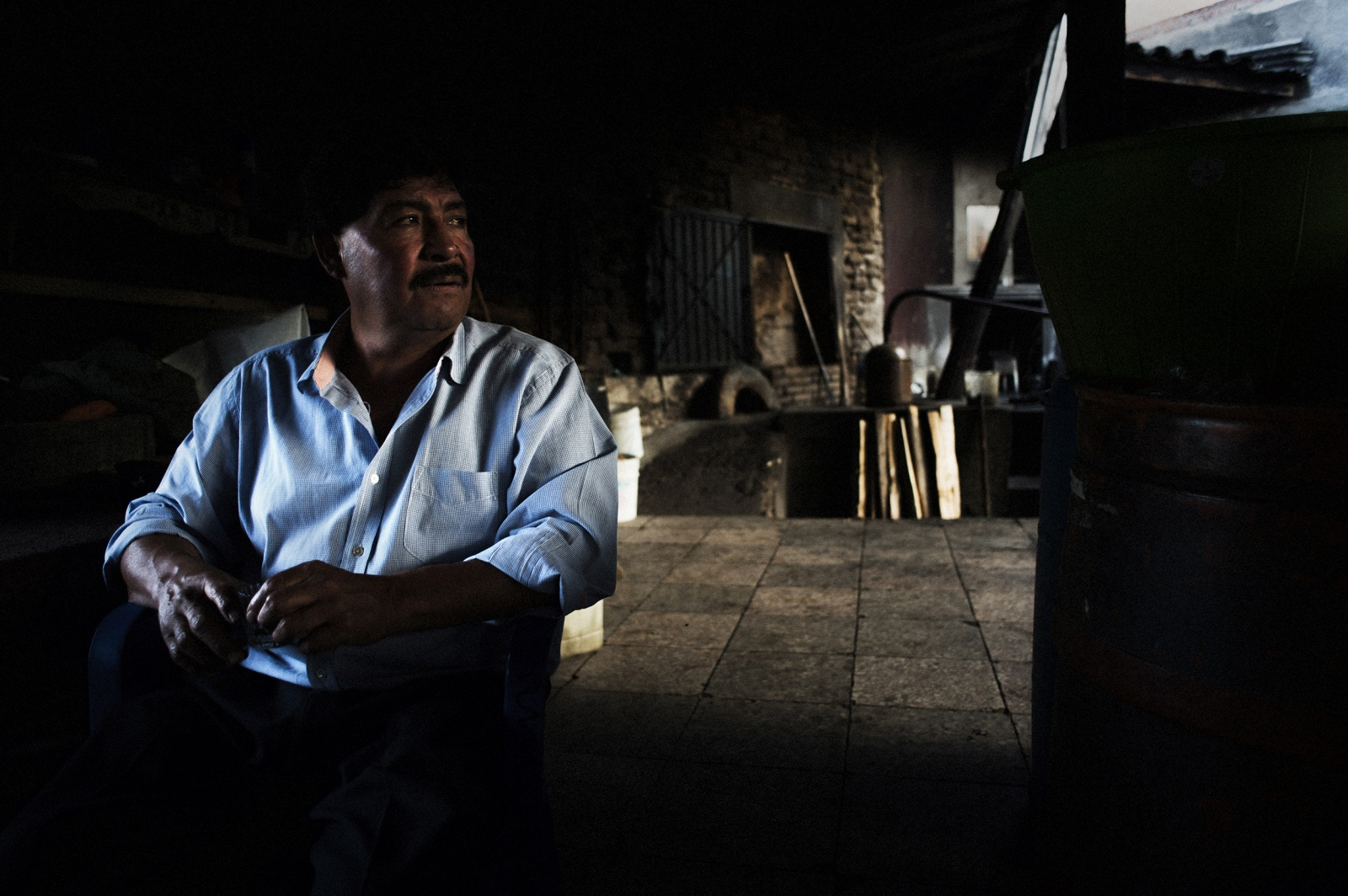 Octavio Jiménez Monterroza enjoys a glass of mezcal with friends. The future of the industry is in question, as demand is quickly outstripping supply and those trying to preserve the traditional, artisinal means of production are having to compete with larger producers.