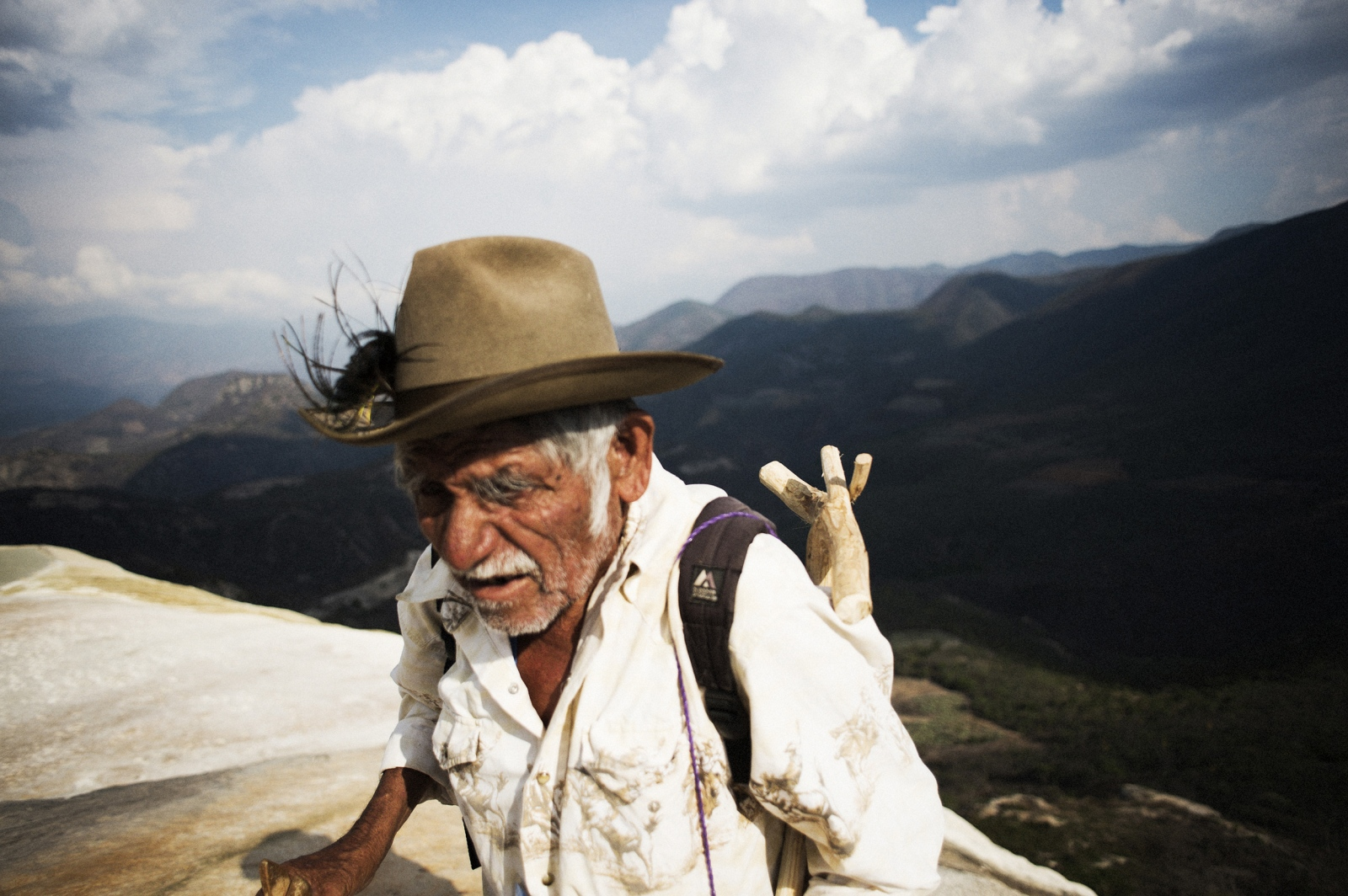 A guide in the Oaxaca hills hikes through the mountains while attempting to locate wild agave.