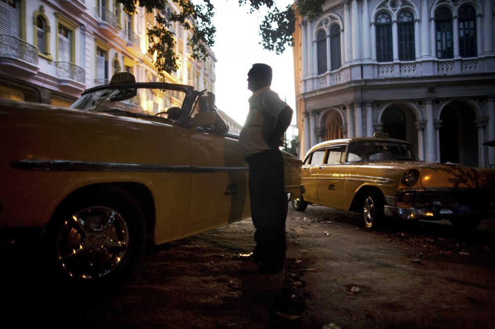 State employed taxi drivers wait for fares in Havana Vieja, Cuba.