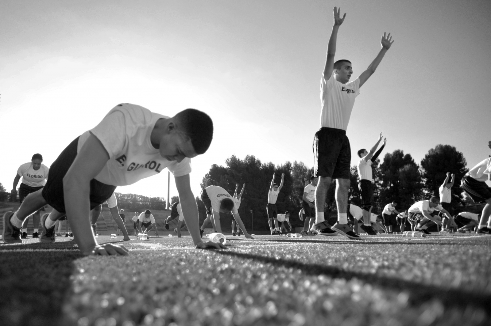 Recruits do burpees as part of their physical training before class at College of the Canyons on Sept. 27, 2014.