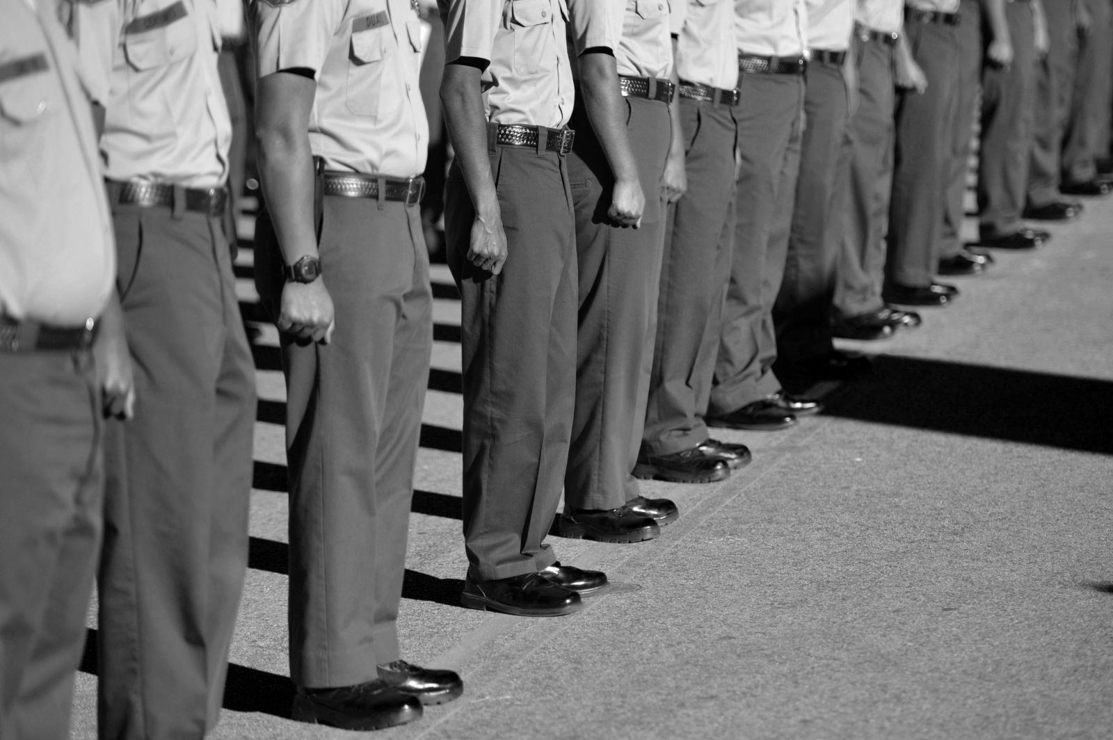 Recruits stand at attention just before the graduation ceremony begins at Whittier High School on Jan. 17, 2015.