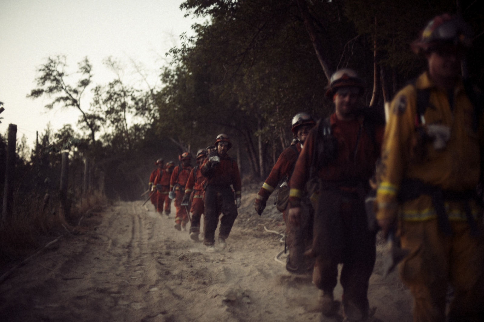 Antelope Conservation Camp firemen are led in formation by a Cal Fire captain during a 24 hour shift fighting fires in Sonoma, CA, during the devastating wine country fires.