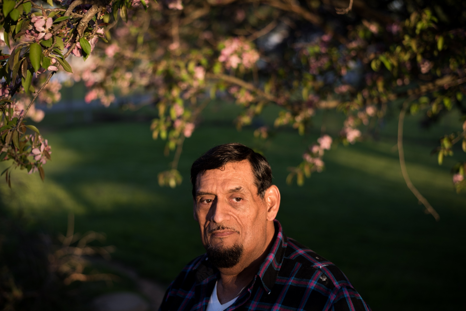 Roland Garcia poses for a portrait in his backyard in Coolville, Ohio in April 2015. In 2006, Garcia and his partner, Tom, started looking to move from Florida to Southeast Ohio to be closer to Garcia's mom who was in poor health. They found a 100-year-old house in Coolville, fell in love with it immediately, and left before even looking around town. In the process of moving, Garcia's mother passed away. Garcia and Tom made a decision to stay in Coolville. Garcia says that his co-workers at Coolville's Arcadia Nursing Home became a second family to him. They were there to console and support him when Garcia was diagnosed with cancer and when Tom, his partner of 35 years, died of a heart attack this past November. Garcia says that despite the impression some people have that residents of Southeast Ohio are all close-minded, he has never received any ill will for his heritage or sexual orientation. He says he has found compassion here.