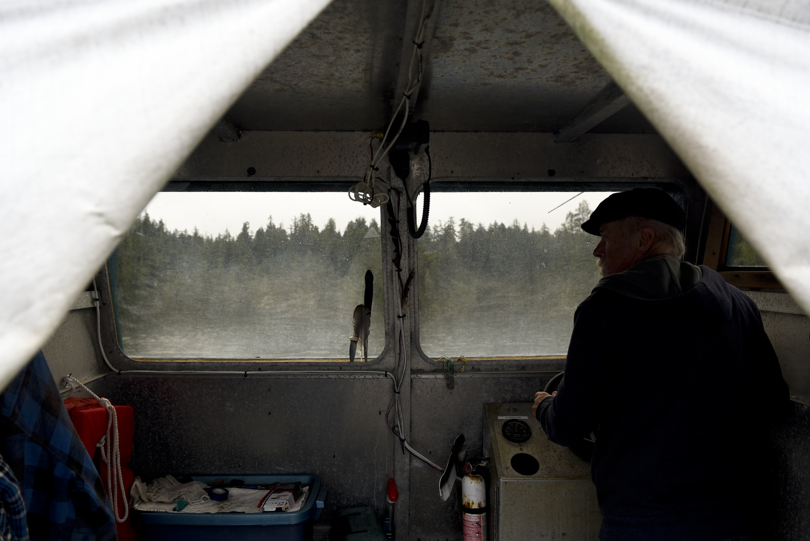 "Wayne Adams drives his boat, named ""Fireweed."" Adams has to fish everyday for food as the floating home has no refrigerator or freezer. ""We don't have to worry about keeping our food fresh,"" Adams said. ""Because we eat fresh."""