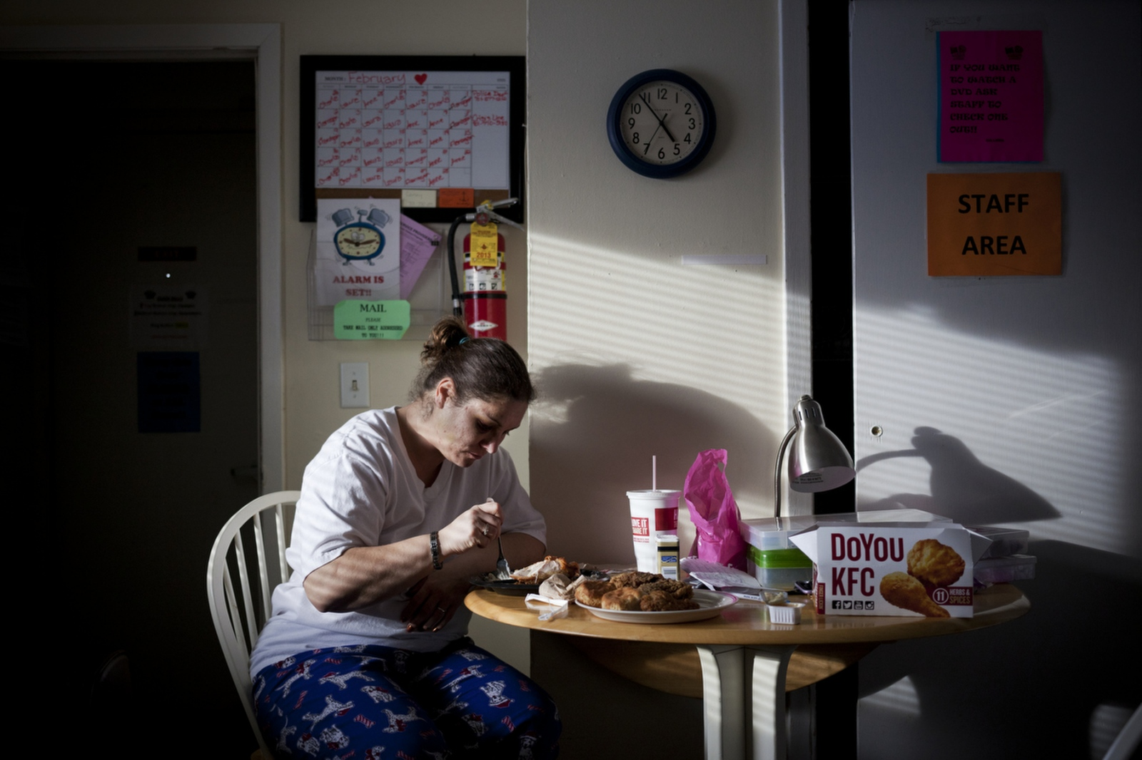 Maria eats dinner at the crisis shelter after she visited the hospital regarding her injuries sustained during a fight with her ex-boyfriend. On average, women leave seven times before permanently leaving.
