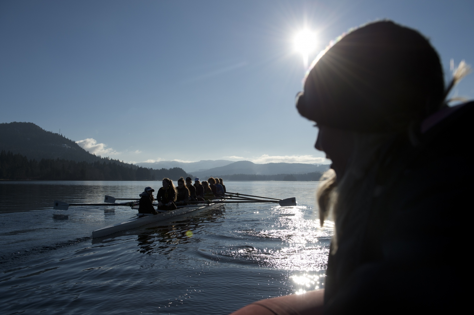 "Shawnigan Lake School student rowers sit in a coxed eight during practice on Jan. 9, 2016. The lake is home to two boarding schools, Dwight School Canada and Shawnigan Lake School. The lake is also training grounds for Rowing Canada. ""I don't think there is a kid that can go through their education at the school without experiencing the lake in a positive way,"" Colin Mattock, teacher and coach at the school, said."