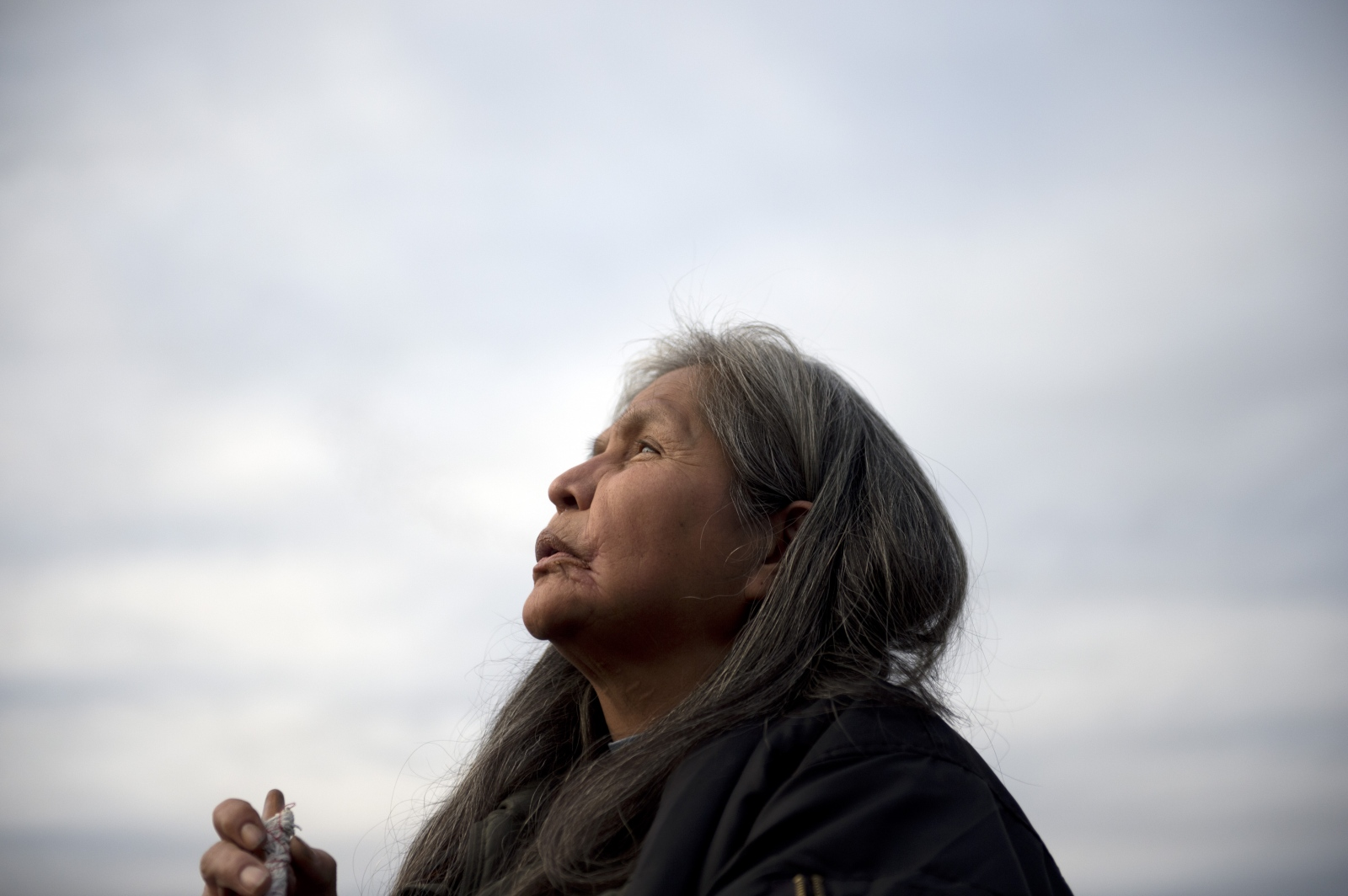 "Rose Henry, of Victoria, B.C., participates in a sacred pipe ceremony in Shawnigan Lake, B.C., on Sunday, Feb. 7, 2016. Members of the Shawnigan Lake community gathered to watch and take part in the ceremony of healing. ""We are here defending our most sacred thing — the water,"" Henry said."