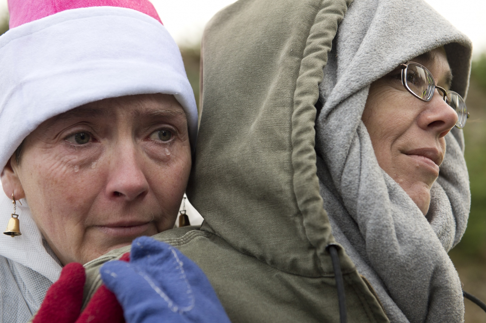 "Shelagh Bell Irving, left, cries while supporting Jacqui Gilbert, right, as they watch Gilbert's husband Troy Lywood get arrested for impeding dump trucks en route to the South Island Resource Management site on Dec. 22, 2015. Lywood was one of nine protestors arrested on Dec. 22. ""I feel like the luckiest woman in the world,"" Gilbert said. ""My husband will stand solidly for what he believes. It's a testament to his character."""