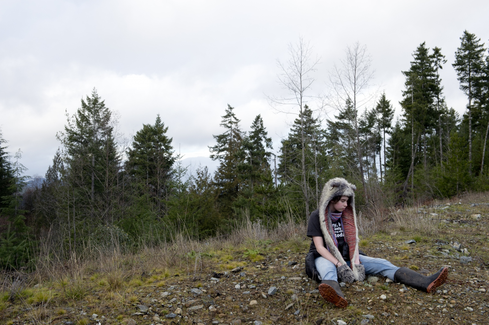 Claire Keen, 15, of Shawnigan Lake, rests during a public tour around the dump site on Sunday, Dec. 20, 2015.