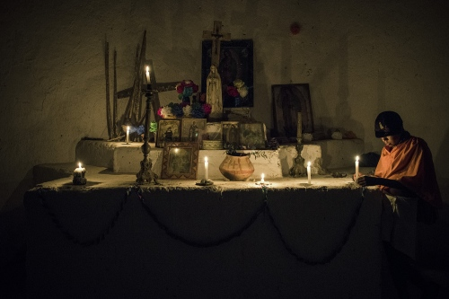 A Raramuri boy keeps the candles alight during the Virgen the Guadalupe celebration that lasts the whole night.