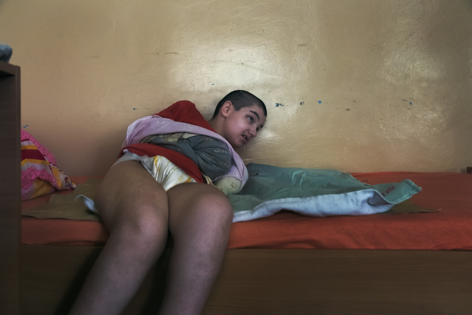 The children are not properly diagnosed and are kept restrained in their beds.