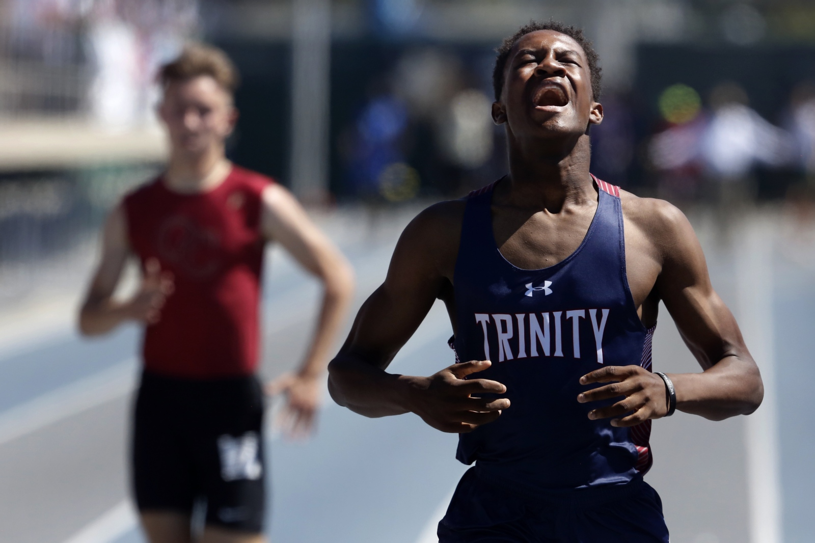 Trinity's Solomon Strader finishes the 400 meter dash at the CIF-Southern Section track and field finals at Cerritos College on Saturday, May 20, 2017. Katharine Lotze/The Signal
