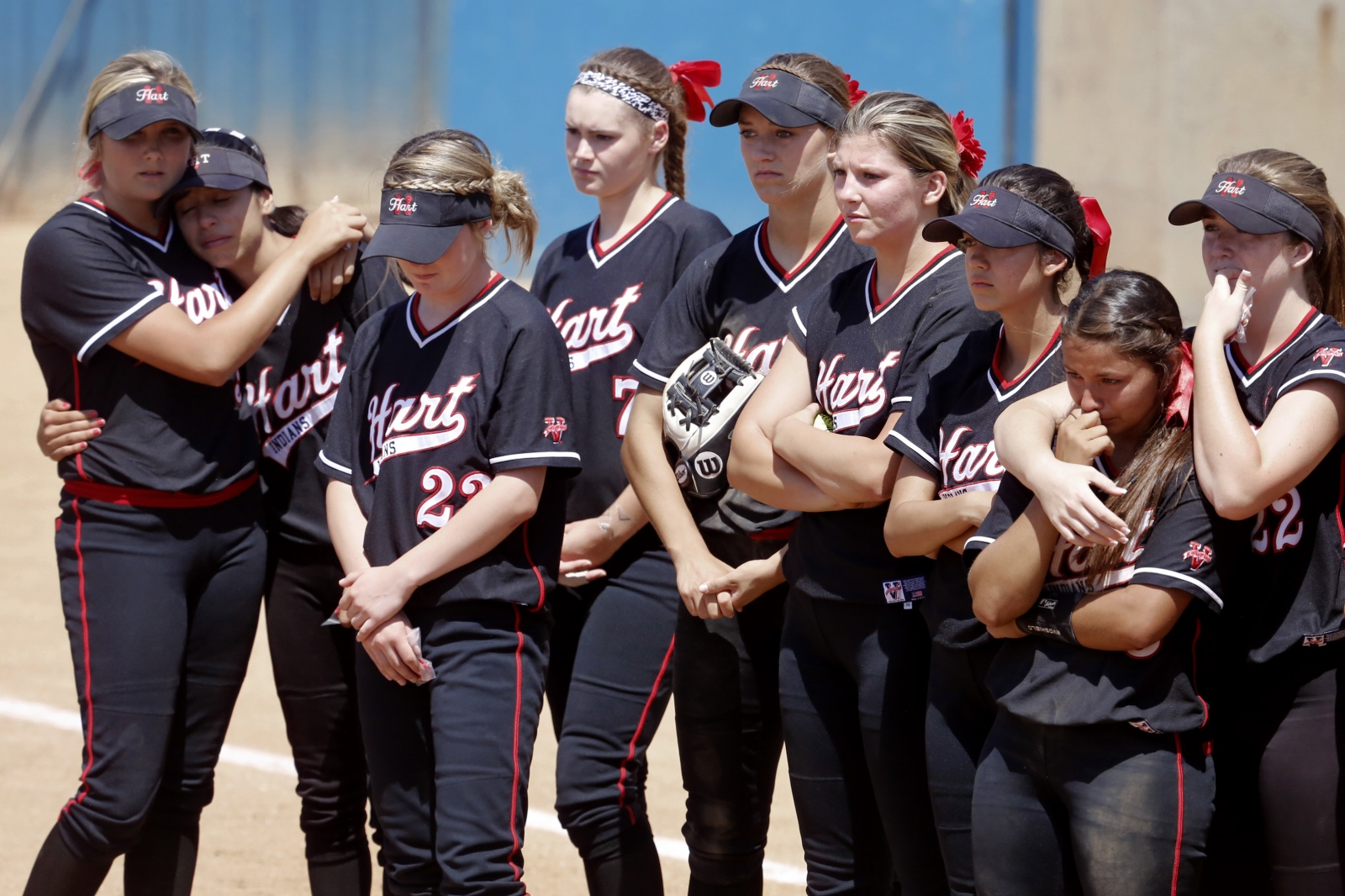 The Hart varsity softball team mourns their loss to Murrieta Mesa during the CIF Southern Section softball championship game in Irvine on Saturday, June 3, 2017. Katharine Lotze/The Signal