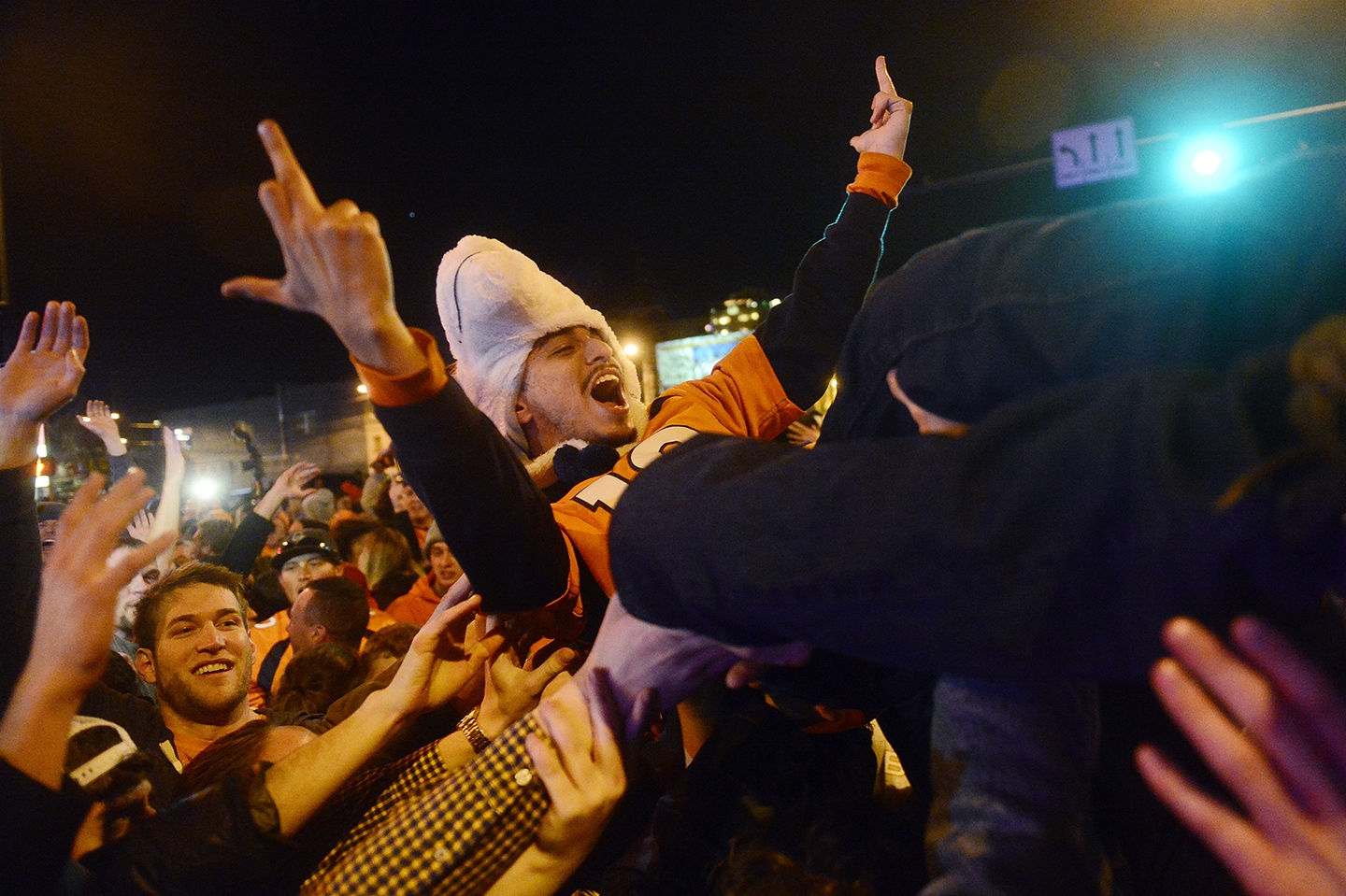 Denver Celebrates Broncos' Super Bowl Win A fan crowd surfs at the intersection of 20th St. and Market St. on February 7, 2016 in Denver, Colorado. Fans celebrated in the street of Denver after the Denver Broncos defeated the Carolina Panthers 24-10 to win Super Bowl 50. (Photo by Brent Lewis/The Denver Post)