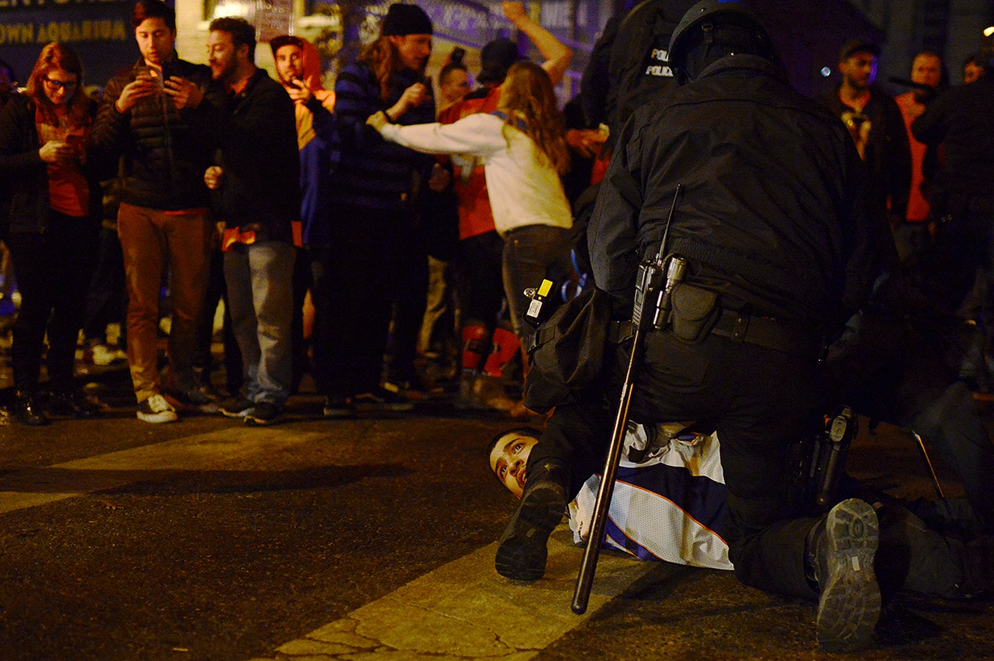Denver Celebrates Broncos' Super Bowl Win A man is held down by police after being dragged out of his car and restrained at the intersection of 21th St. and Larmier St. on February 7, 2016 in Denver, Colorado. Fans celebrated in the street of Denver after the Denver Broncos defeated the Carolina Panthers 24-10 to win Super Bowl 50. (Photo by Brent Lewis/The Denver Post )