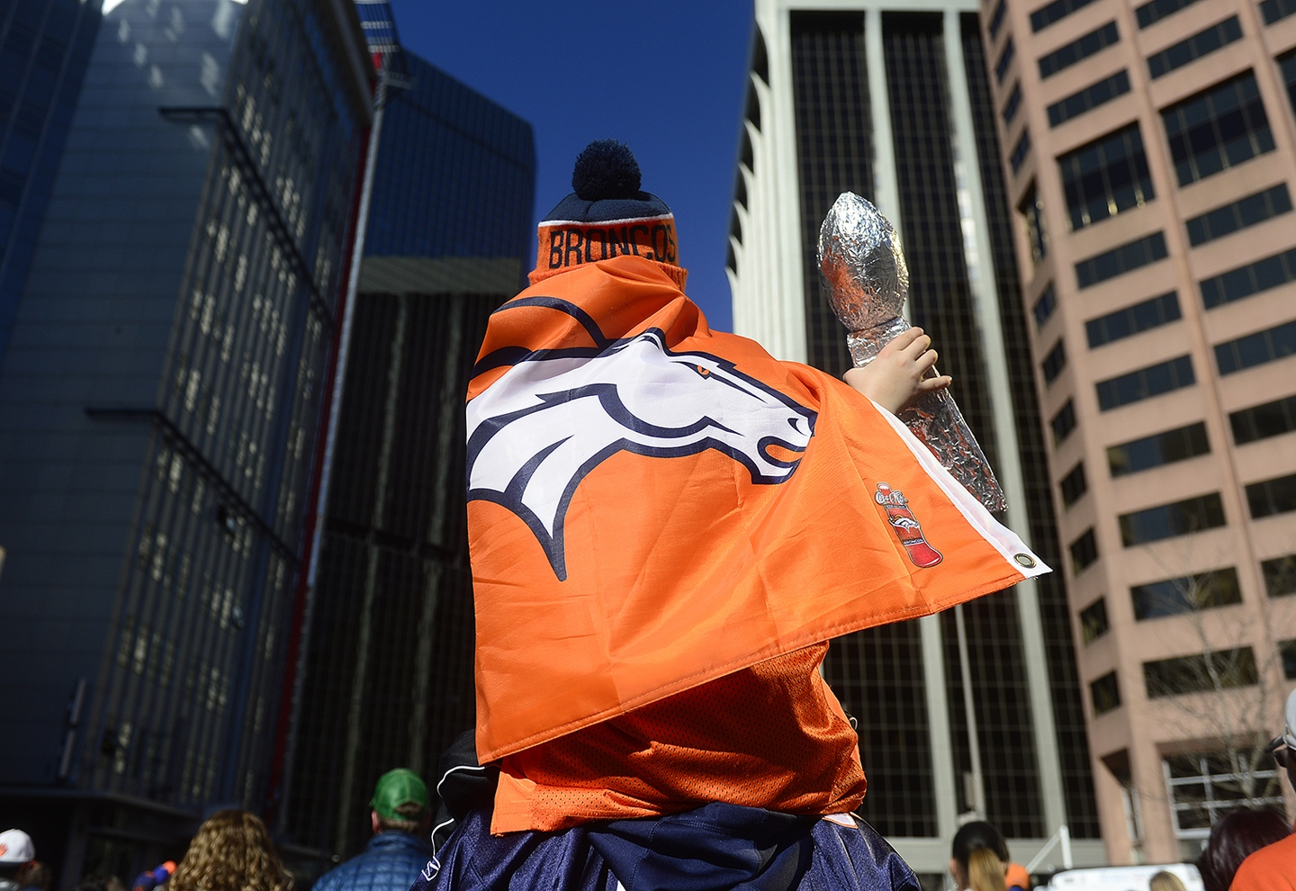 Denver Broncos Fans Rally After Super Bowl Win Matthew Jayne raises his Lombardi trophy made out of aluminum foil abouve the crowd while leaving downtown on February 9, 2016 in Denver, Colorado. Fans gathered to celebrate the Denver Broncos' Super Bowl win with a parade and a rally in Civic Center Park. (Photo by Brent Lewis/The Denver Post)