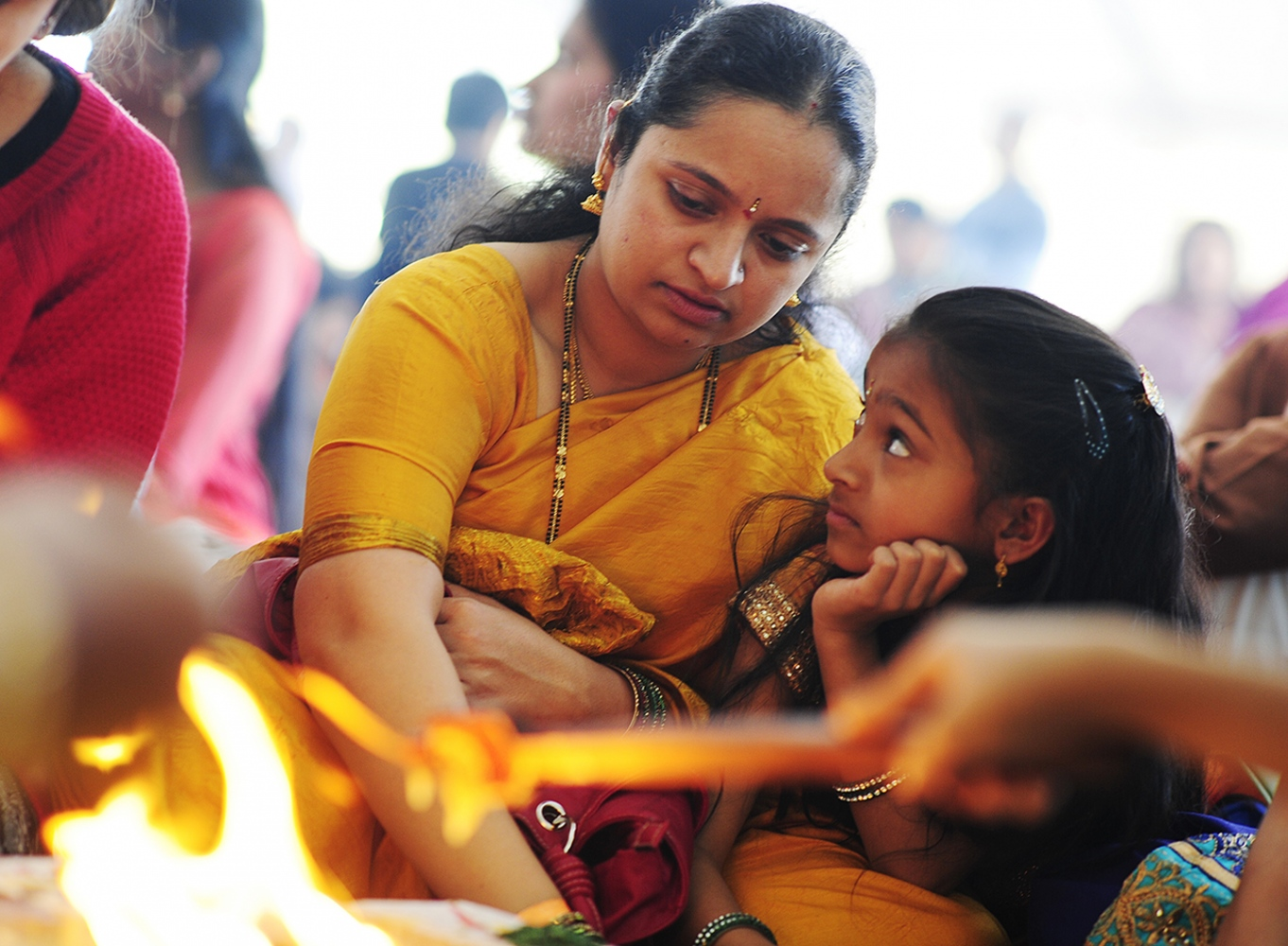 Welcoming A Permanent Sai Baba in Hindu Temple Shilpa Polakam makes sacrifices while her daughter, Sarayu, 8, watches on during a havan at the Shri Shirdi Saibaba Temple of Rockies on February 27, 2016 in Centennial, Colorado. The worshippers of the temple held a havan, which is a fire ritual where they make offerings, to provide energy to bring to life their permanent statue of Sai Baba. Outside of the havan, they made offerings to take the figure through a purification ritual before setting it in it's permanent place Sunday. (Photo by Brent Lewis/The Denver Post)
