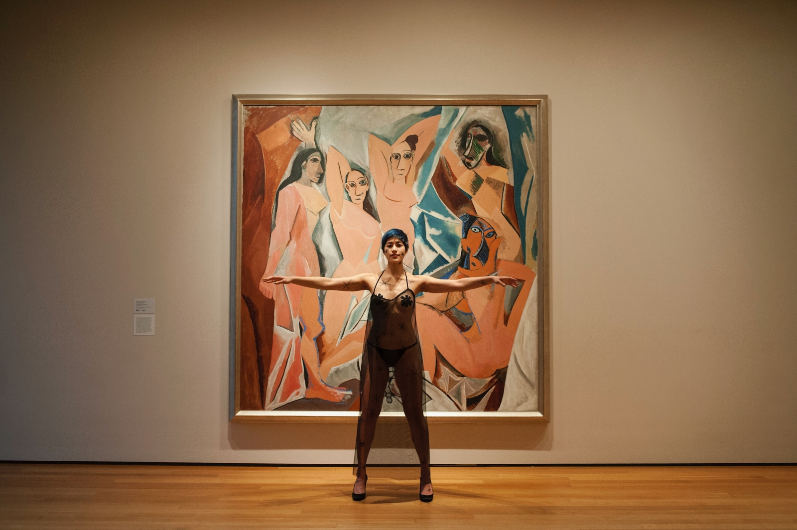 Emma Sulkowicz photographed in protest alongside Pablo Picasso's Les Demoiselles d'Avignon at the Museum of Modern Art