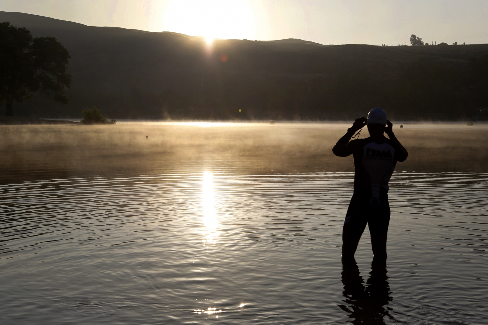 A swimmer looks out across Castaic Lake's Lower Lagoon ahead of the World Police and Fire Games triathlon competition on August 14, 2017. Katharine Lotze/The Signal