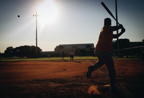 Jody Roof waits for the pitch during intramural softball play on Langley Air Force Base. September 11, 2012.