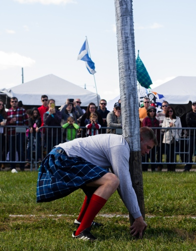 "Strongman competitor attempts to toss a large tapered pole called a ""caber"" during the Central Virginia Celtic Highland Games. The caber stretches 19ft. long and weighs 175lbs. October 22, 2016."