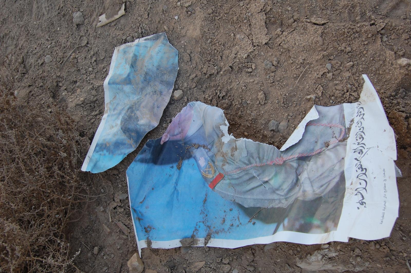 War-torn propaganda from an old regime found near Nasiriyah, Iraq. February 2009.