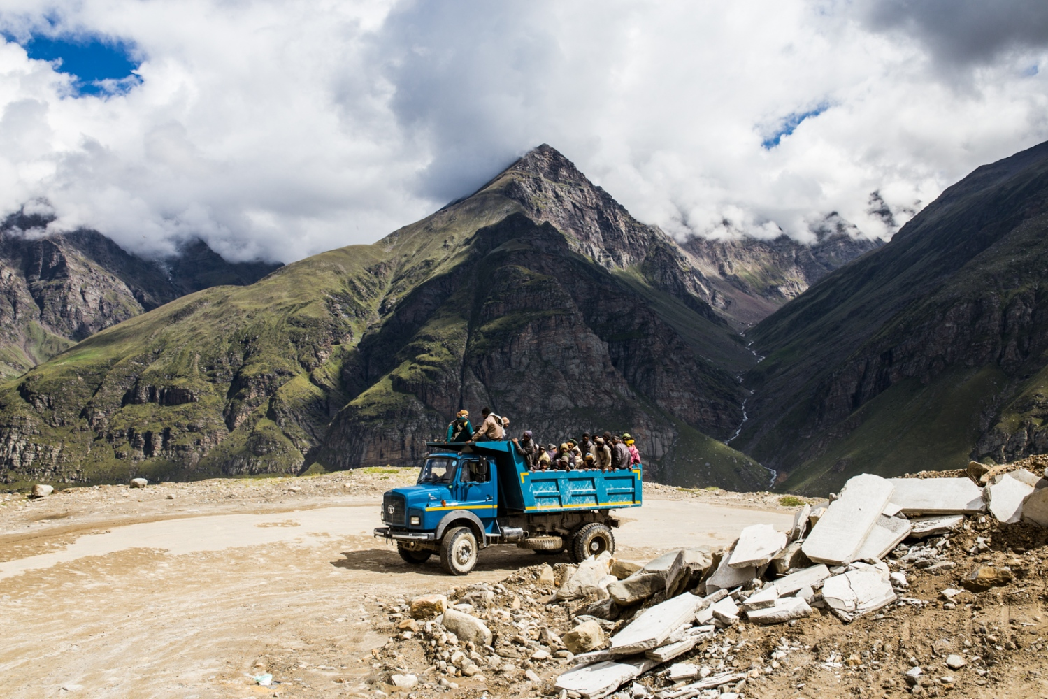 Diesel powered truck transports migrant workers on the ever expanding Himalayan roads of India. Unfiltered and old diesel trucks release large amounts of black carbon, a dark particle that absorbs sunlight and heats the surrounding area. Black carbon has been shown to exacerbate the impacts of climate change in the Himalayas, which is warming faster than any other place on the planet, excluding the Arctic.