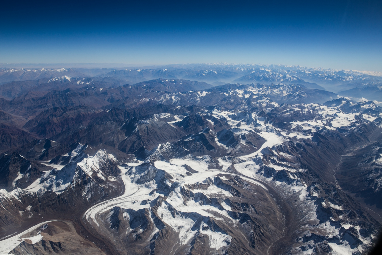 Arial photo of retreating Himalayan glaciers. The Himalayas is one of the fatest warming regions on the planet, excluding the arctic. The thawing of ice is one of the surest signs of a warming climateregime.