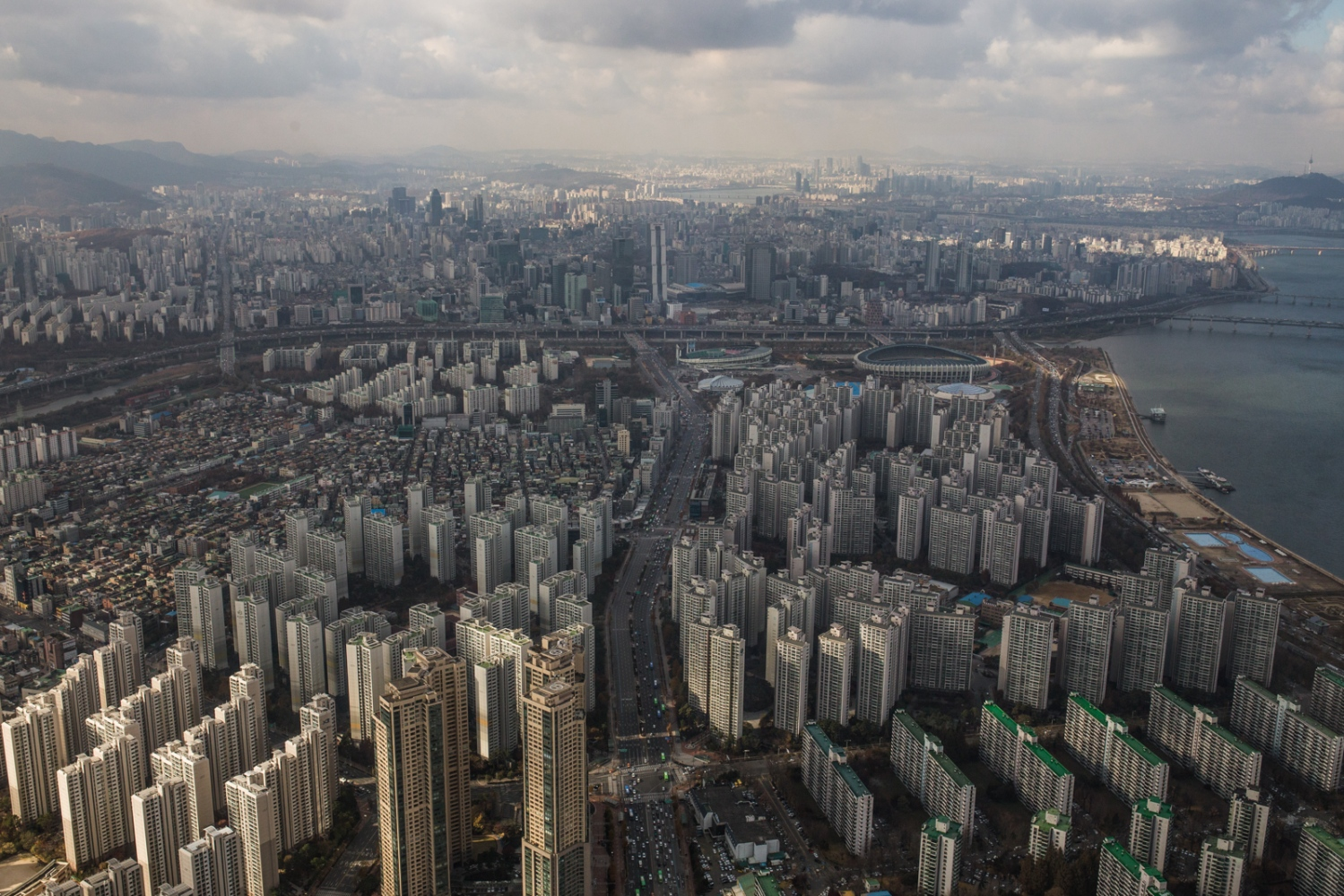 The ever-expanding skyline of Seoul, South Korea. Mega-cities have a large part to play in humanities adaptation to climate change. Cities are population sinks and as more of humanity is concentrated into cities it is crucial that we source our energy from clean sources that move away from fossil fuels. Most major cities across the globe are still powered by fossi fuels, such as coal.