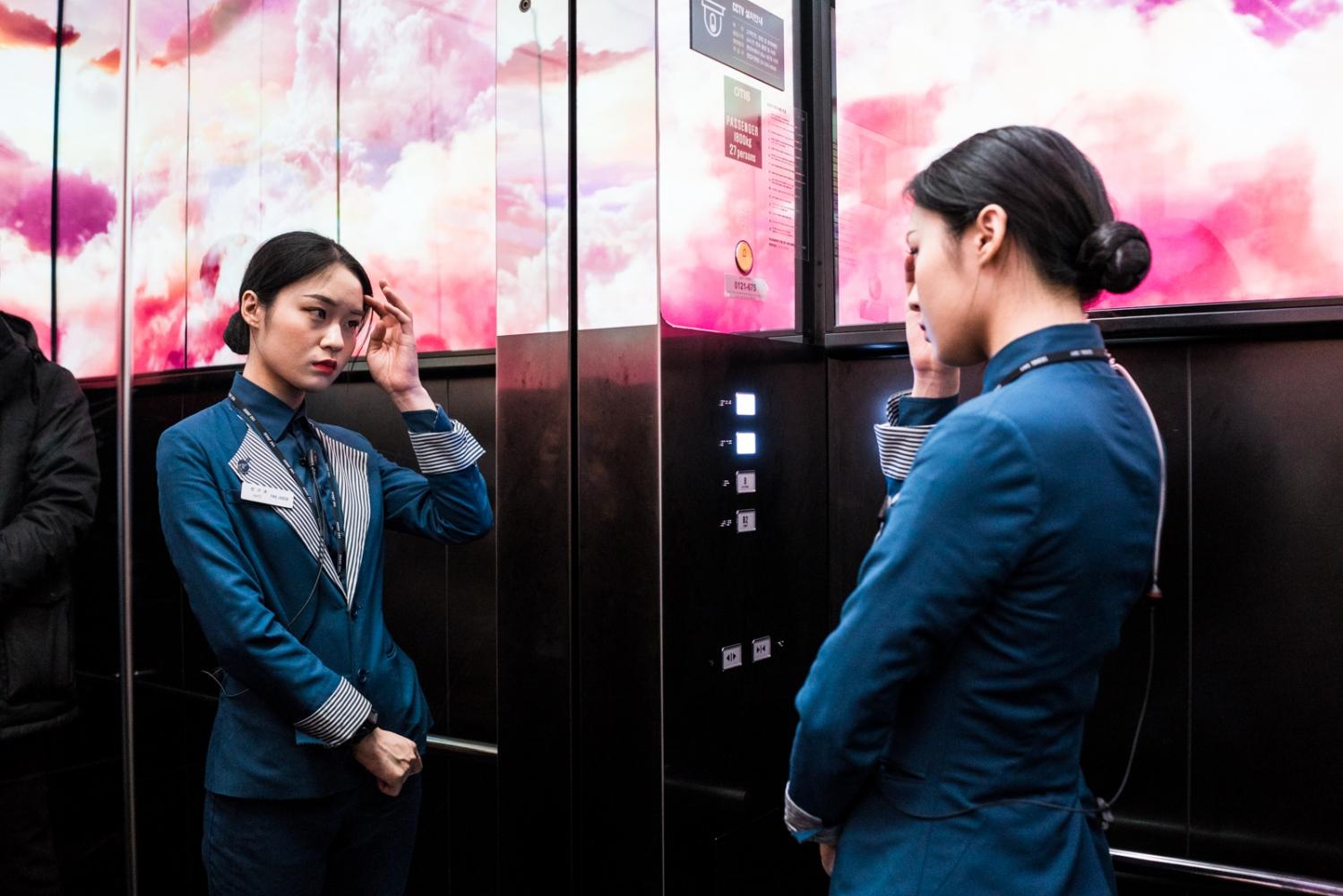 Elevator hostess. Seoul, South Korea.
