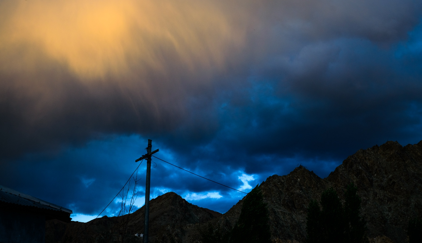 Dense rainclouds loom over the village of Choglomsar, Ladakh, where in 2010, a catastrophic 'cloudburst' event wiped out the entire town, claiming over 200 lives and causing major infrastructure damage all around the region.