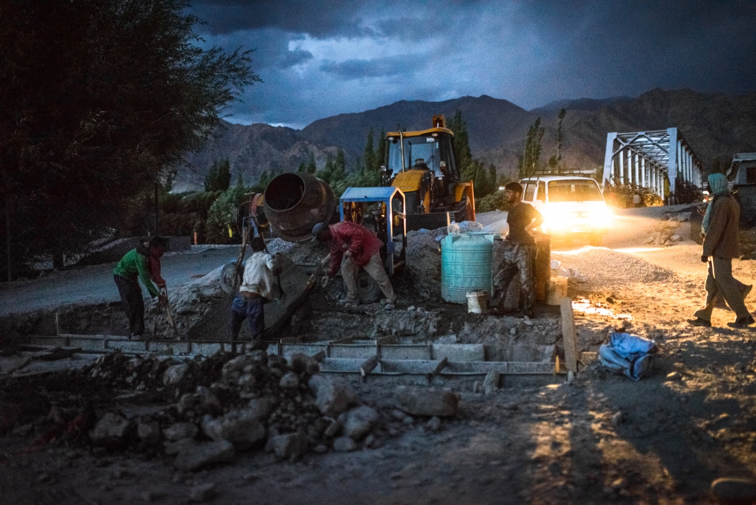 Workers near Choglomsar, Ladakh work into the twilight to finish building underground irrigation canals after the 2010 'cloudburst' event had destroyed most rural water infrastructure in the vicinity.