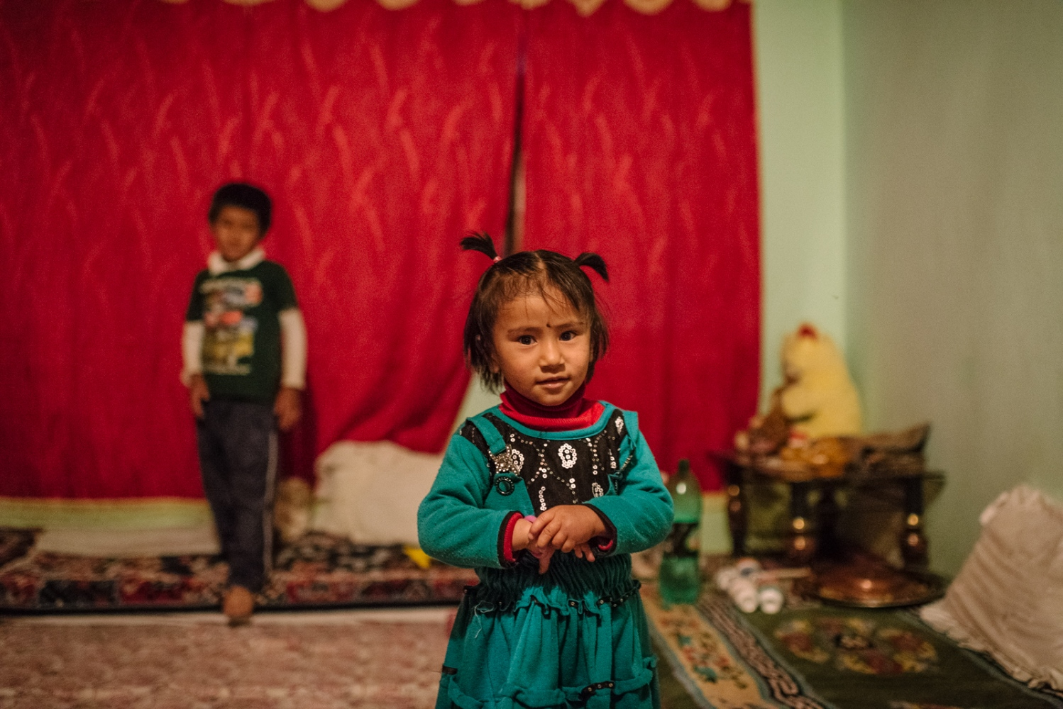 Young Muslim children play at their home during a family reunion celebrating 'Iftar' near Choglomsar, Ladakh.